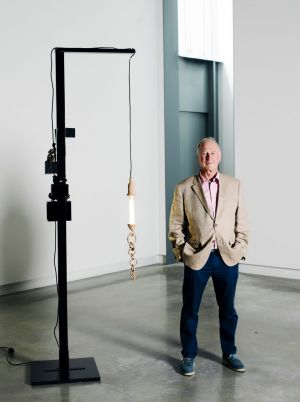 Michael Buxton, in the Buxton Contemporary museum, by Mikala Dwyer sculpture, Black lamp with Madonna and magnetic ...