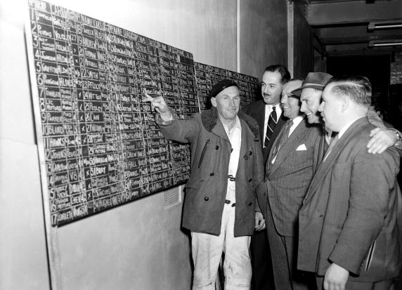 Checking the leader board at the R.A.C.V depot in St Kilda.