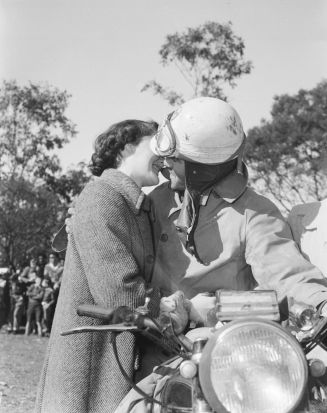 Keith Stewart, winner of the Redex 2000 Mile Reliability Trial for Motorcycles, gets a kiss from his fiance after ...