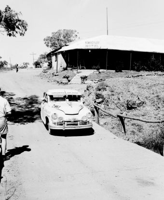 No time for a drink. Passing the Kimberley Hotel in 1955.