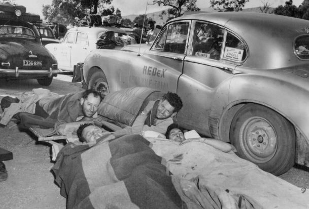 A Jaguar crew settles down for the night in Alice Springs in 1953.