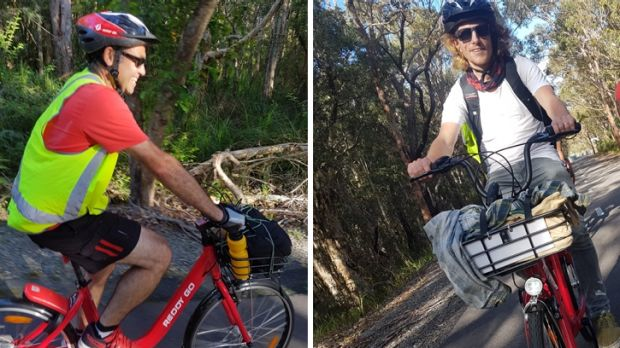Still smiling: Jose Aragon, left, and Jason Sylvester ride from Sydney to Newcastle on Reddy Go bikes.