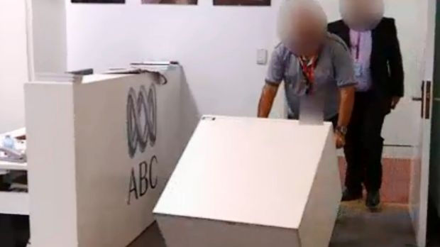ASIO staff enter the ABC's parliamentary bureau to secure the cabinet files last week.