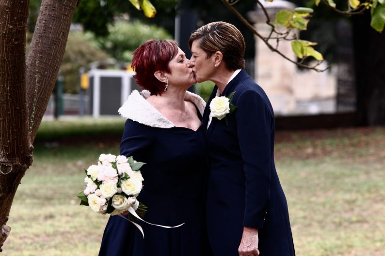 Virginia Edwards and Christine Forster in the Sydney Royal Botanical Gardens before their wedding ceremony.