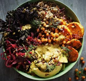 Sweet potato and kale bowl with quinoa, coriander tahini dressing and crispy chilli-lime chickpeas.