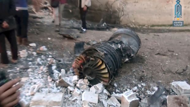 A photo supplied by the media arm of al-Qaida's branch in Syria shows part of a Russian plane that was shot down by ...