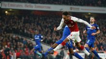 Arsenal's Pierre-Emerick Aubameyang takes a shot on goal during the English Premier League soccer match between Arsenal ...