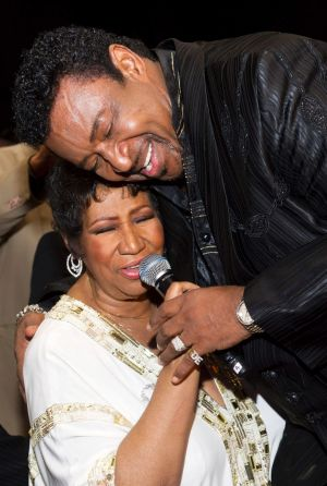 Aretha Franklin sings with Dennis Edwards at her 69th birthday party in New York, 2011.