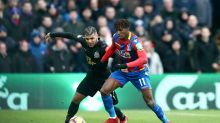 Crystal Palace's Wilfried Zaha, right, and Newcastle United's DeAndre Yedlin battle for the ball during the English ...