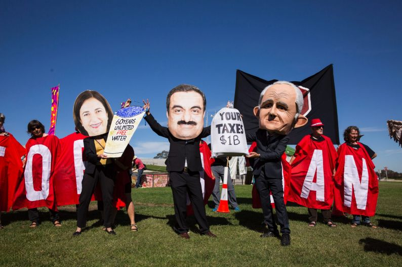 People gather at Parliament House in Canberra to protest the proposed Adani Coal Mine.