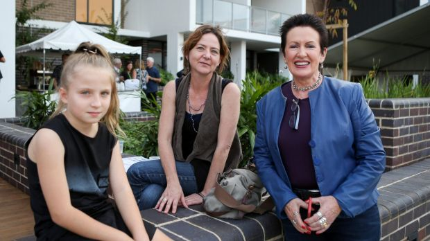 Clover Moore with Vanessa and Annemiek Owens at a welcome party for the first residents to move into the Green Square ...