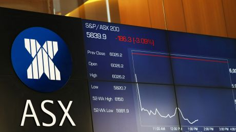 An electronic board displays stock information at the Australian Securities Exchange, operated by ASX Ltd., in Sydney, ...