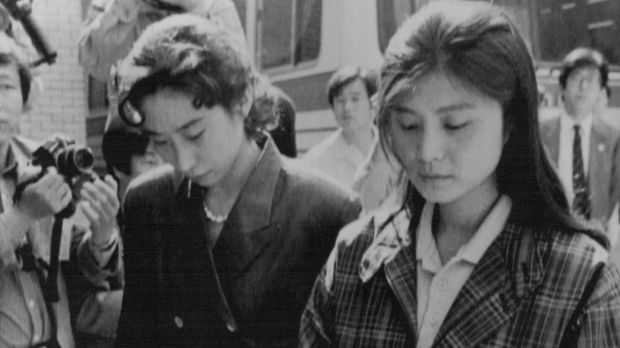 Confessed North Korean agent Kim Hyon-hui, right, enters court during her trial..Kim was sentenced to death for the 1987 ...