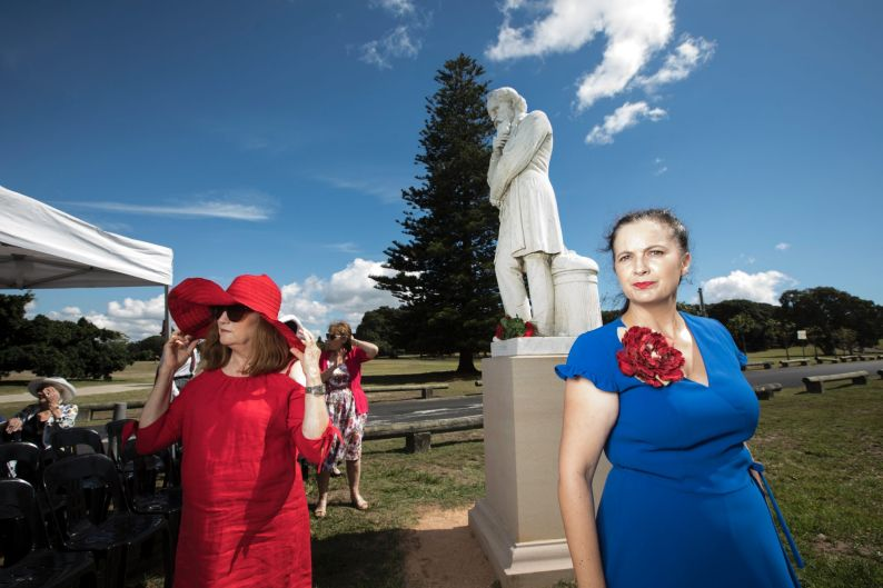 Louise Owens, President of NSW Dickens Society in the blue dress stands by one of the only Charles Dickens statues which ...