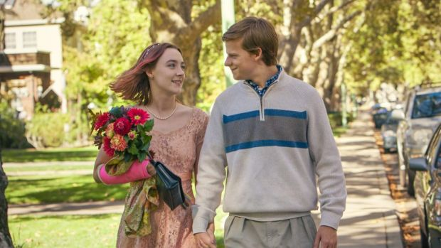 Saoirse Ronan, left, in a scene with Lucas Hedges.
