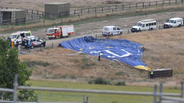 Police and paramedics at the scene of the balloon accident.