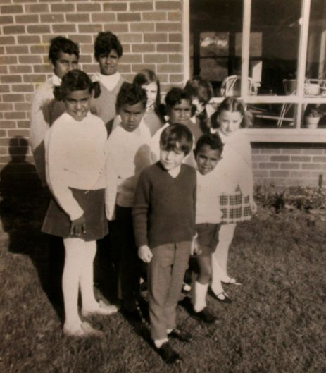 Reg and Mick (back), Alice, Wally and Maria (middle), and Kutcha Edwards (front) with other children at the Orana ...