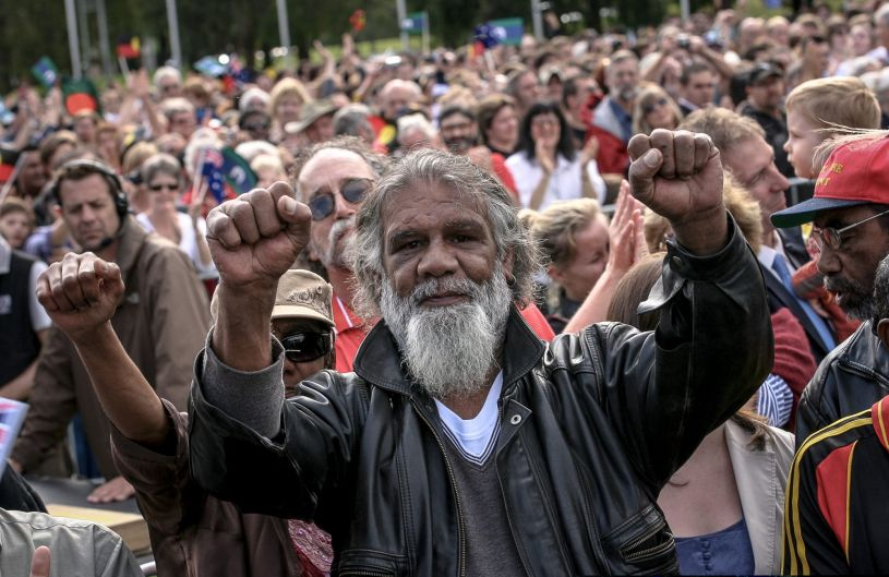 Reg Edwards raises his fists in triumph after the apology speech.