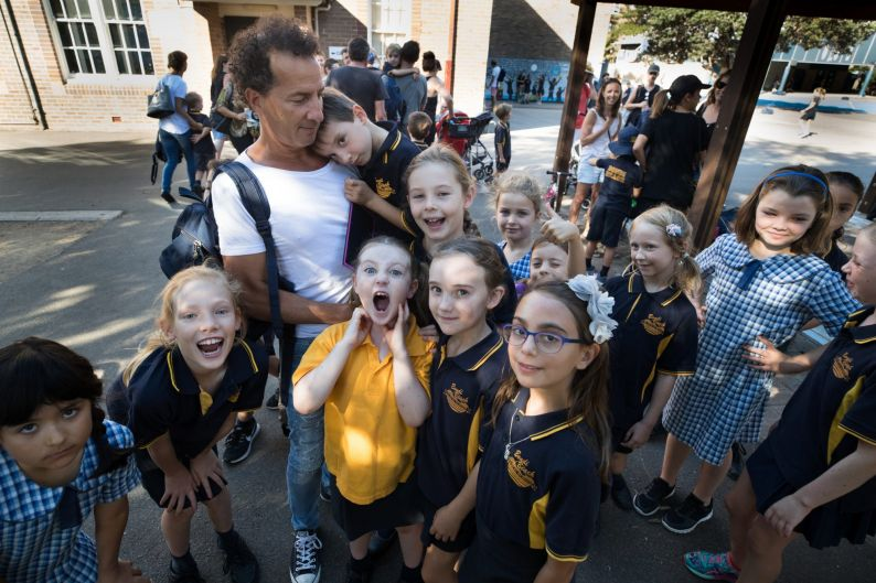 Rob Keldoulis holding his son, Archie, with other students from Bondi Beach Public School, are unhappy that there are ...