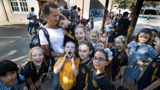 Rob Keldoulis holding his son, Archie, with other students from Bondi Beach Public School, is unhappy there are not ...
