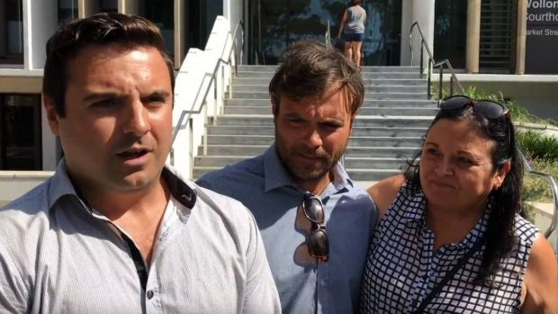 Matthew Domio (left) pictured with his brother Shane and mother Julie Morgan, speaks to the media outside court after ...