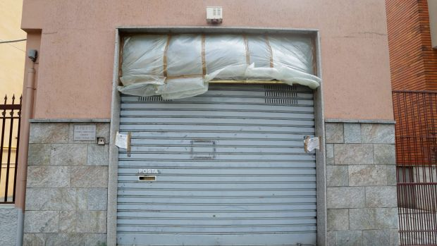 Italian Police's seals are placed on the shut gate of the photo studio, where according to investigators, Lukasz Pawel ...