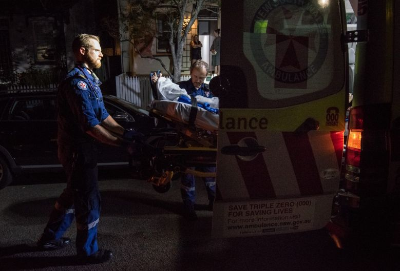 11:04pm. NSW Ambulance Paramedic Gareth Garne (left) loads a 70 year old male from Leichhardt into an ambulance. He ...