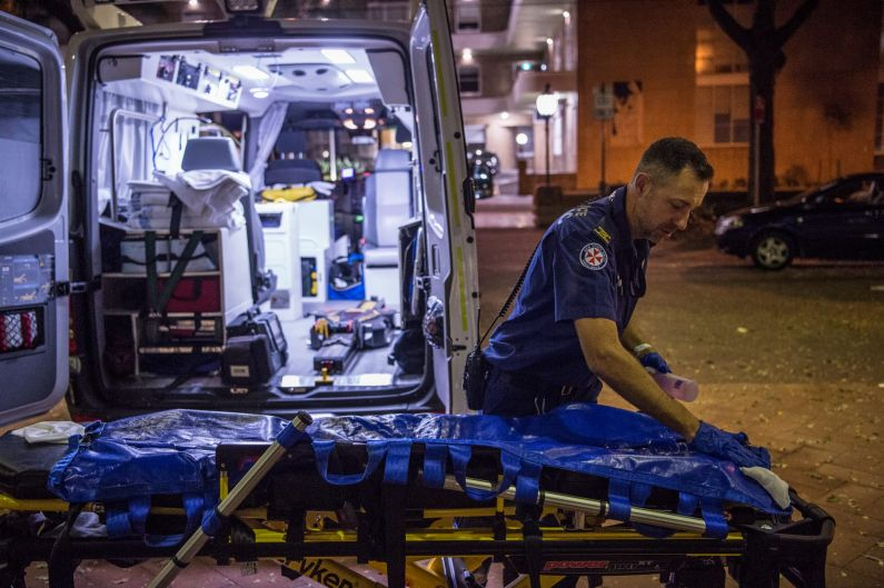 11:38pm. NSW Ambulance Paramedic Eugene Roser cleans the trolley after transporting a 70 year old male from Leichhardt ...
