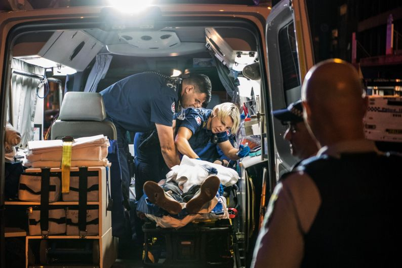 2:14am. NSW Ambulance Paramedics and Police officers perform CPR on a 40 year old male who collapsed with a cardiac ...