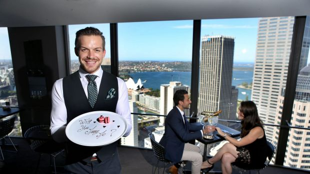 Floor manager Thomas Philbin-Malucelli with a special dessert prepared by the staff of the O Bar and Dining in Sydney's CBD.