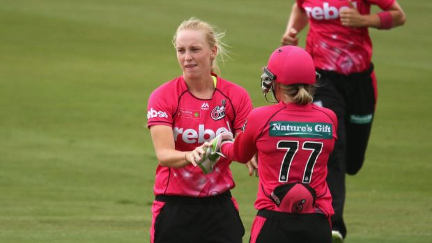 Not returning: Kim Garth is congratulated after a wicket.