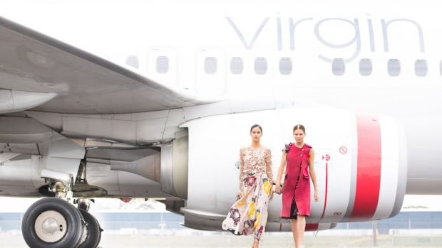 Thirteen models will appear in the in-flight runway show, which will last a total of just three minutes, 51 seconds.