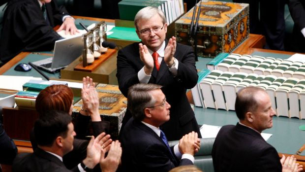 Kevin Rudd applauds members of the stolen generation in the public gallery at Parliament House after delivering his ...