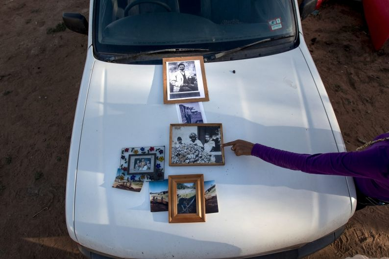 Family pictures on the bonnet of a ute.