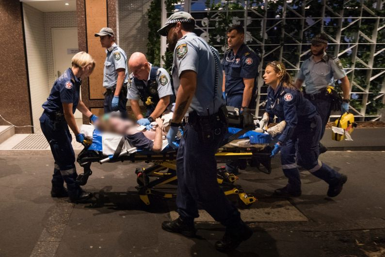 2:11am. NSW Ambulance Paramedics and Police officers perform CPR on a 40 year old male who collapsed with a cardiac ...