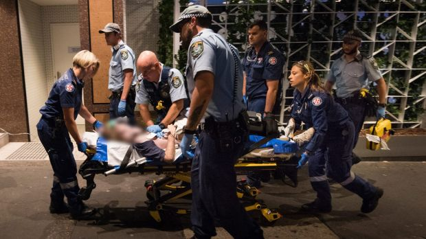 NSW Ambulance paramedics and police officers perform CPR on a 49-year-old man who collapsed having suffered a cardiac arrest.