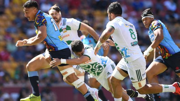 Charge: Lalakai Foketi spies a gap in the Chiefs' defence for the Waratahs in Brisbane.