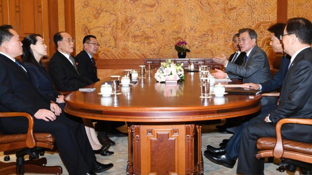 South Korean President Moon Jae-in, third from right, speaks to Kim Yo Jong, second from left, sister of North Korean ...