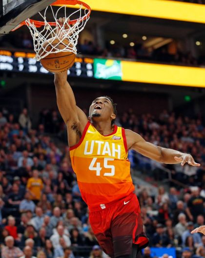Utah Jazz guard Donovan Mitchell (45) dunks against the Charlotte Hornets in the second half during an NBA basketball ...