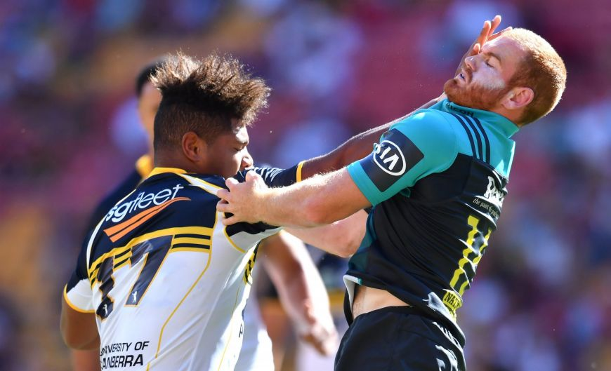 Rob Valetini (left) of the Brumbies palms off Jamie Booth (right) of the Hurricanes during the Brisbane Global Rugby ...