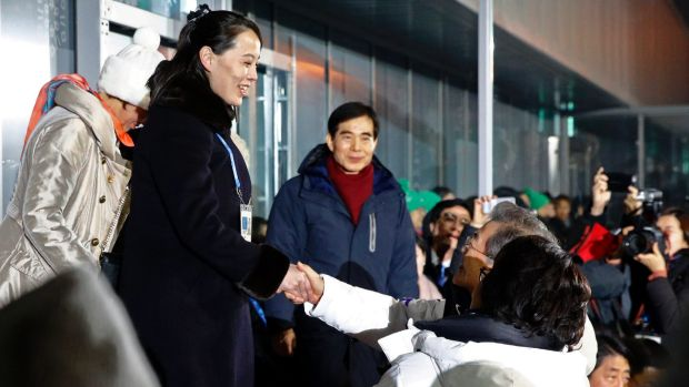 Kim, left, shakes hands with Moon Jae-in at the opening ceremony of the 2018 Winter Olympics in Pyeongchang.