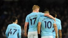 Manchester City's Sergio Aguero, right, celebrates with his teammates at the end of the English Premier League soccer ...