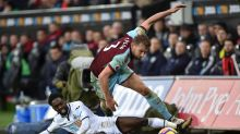 Burnley's Charlie Taylor, right, stumbles while being challenged by Swansea City's Nathan Dyer during the English ...