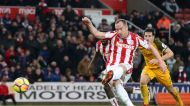 Stoke City's Charlie Adam takes a penalty but misses during the English Premier League soccer match between Stoke City ...