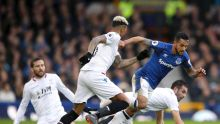 Everton's Theo Walcott, second right, and Crystal Palace's Patrick van Aanholt battle for the ball during their English ...