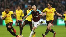 West Ham's Marko Arnautovic, middle, battles for the ball during the Premier League soccer match between West Ham United ...