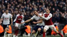 Tottenham's Harry Kane, center, and Arsenal's Hector Bellerin battle for the ball during the English Premier League ...