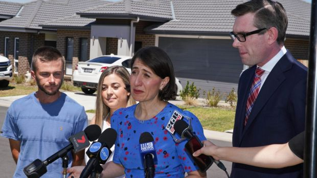 NSW Premier Gladys Berejiklian and NSW Treasurer Dominic Perrottet speaking in Oran Park on Sunday.