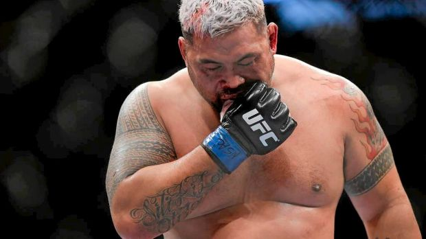 Mark Hunt removes his mouthpiece in between rounds at UFC 160 in Perth.