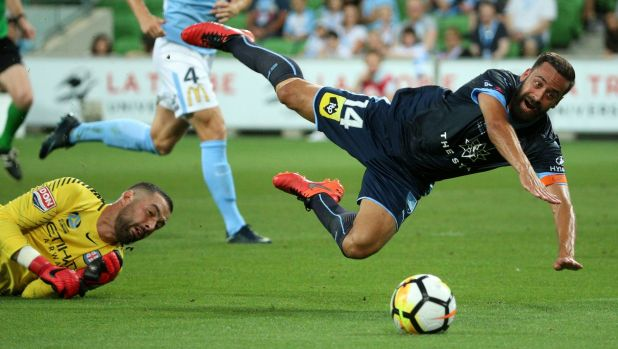 Tumble: Alex Brosque is brought down by goalkeeper Dean Bouzanis to earn the penalty that resulted in Sydney FC opening ...